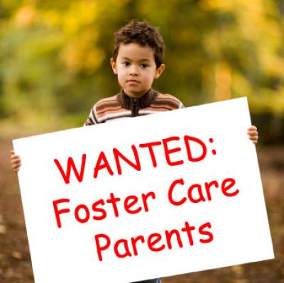 Kid holding foster parent sign